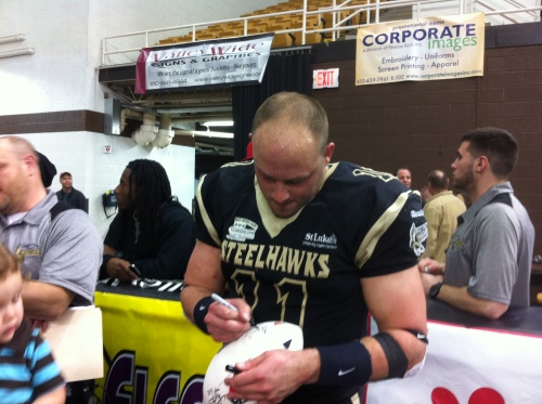 QB Adam Bednarik signs after the game. Photo: Dan