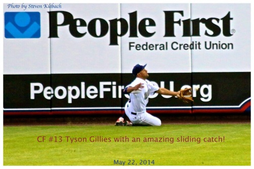 Tyson Gillies makes a sliding grab near the wall in right center.  Photo: Steven Kiebach