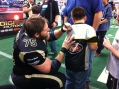 Lefty O-Lineman and Center Darryl Kurtz, a Bloomsburg product, signs for a young fan.  Photo: Dan