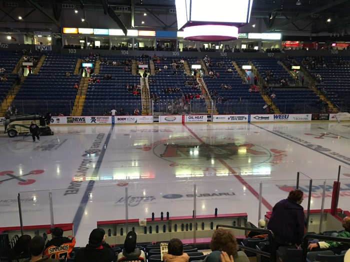 The calm before the storm, as they prepare the ice for the game. Photo: Kram