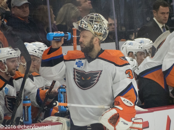 This is why some guys play goalie: poor aim. LaBarbera's mouth is clearly lower than he's shooting the water. Photo: Cheryl Pursell