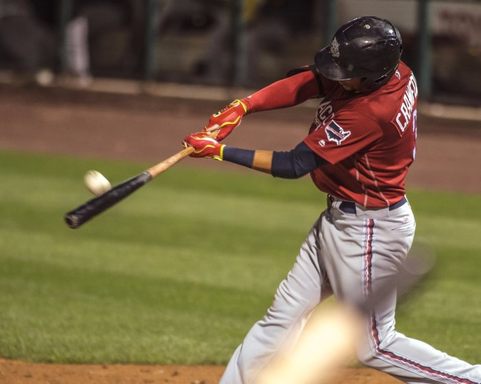 Crawford with a HR. Photo: Cheryl Pursell