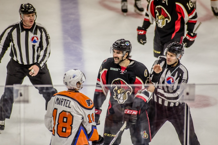 Is that Stortini that Martel is jawing with? I admire your courage Danick, but maybe that's not the right spot for a fight.... Photo: Cheryl Pursell