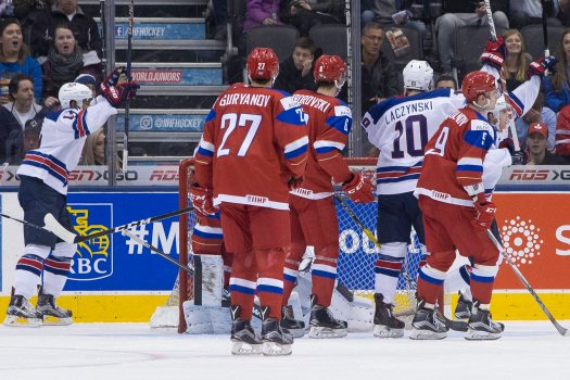 United States center Tanner Laczynski (# 10) raises his stick to celebrate a crucial third period tally which ultimately turned out to be winning goal while Russia winger Denis Guryanov (# 27), the former first round NHL Draft pick who has spent this entire season skating for the Texas Stars in the American Hockey League, can only watch during the 2017 IIHF World Junior Championship preliminary round robin contest at the Air Canada Centre in Toronto ..... (photo courtesy Chris Young / The Canadian Press)