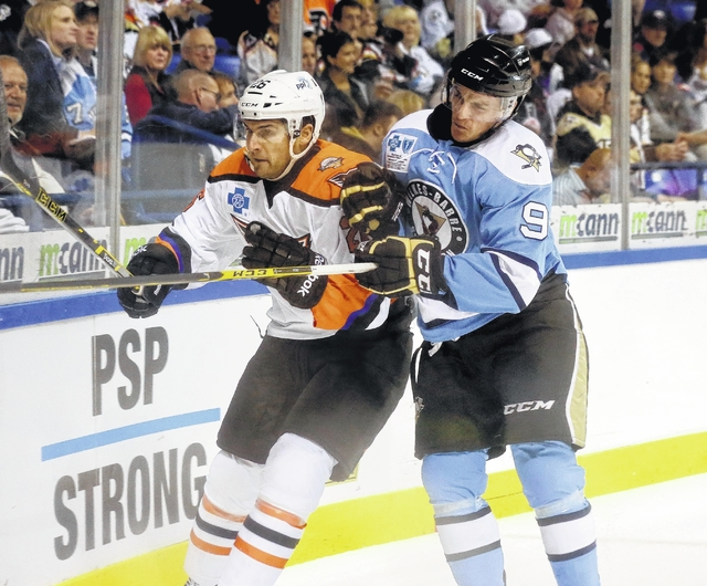 Wilkes-Barre/Scranton Penguins winger Jean Sebastian Dea (# 9), the undrafted 23-year-old forward who spent a little time with the ECHL's Wheeling Nailers during his rookie professional campaign a couple of seasons ago, transforms into a legitimate AHL All-Star when skating opposite the Lehigh Valley Phantoms. Dea has scored nine goals while adding six assists for 15 points in 23 career AHL contests for the Baby Pens against the Hamilton Street Heroes. The good news for Lehigh Valley head coach Scott Gordon this week, though, is that Dea usually does most of his damage on his travels to Allentown, as is evidenced by the fact that seven of his career lamp-lighters versus the Phantoms have come at the perhaps too accommodating PPL Center ..... (photo courtesy Tom Venesky / Times Leader)